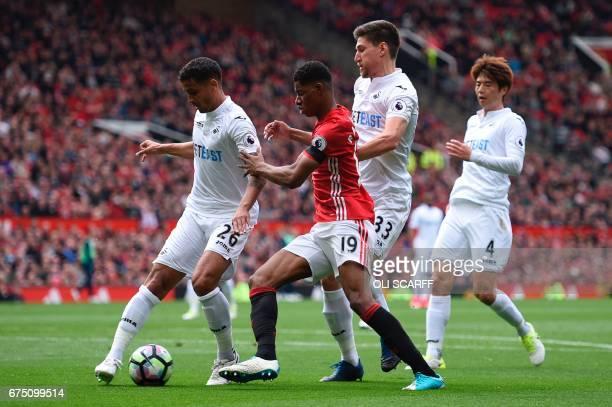 Swansea City's English defender Kyle Naughton Swansea City's South Korean midfielder Ki SungYueng and Swansea City's Argentinian defender Federico...