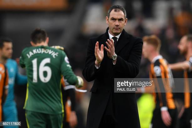 Swansea City's English head coach Paul Clement applauds supporters after the English Premier League football match between Hull City and Swansea City...