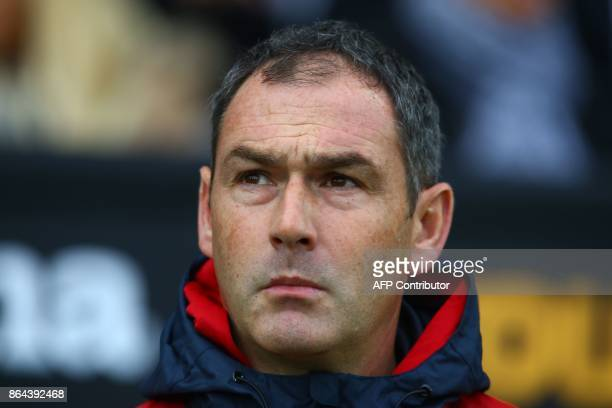 Swansea City's English head coach Paul Clement awaits kick off in the English Premier League football match between Swansea City and Leicester City...