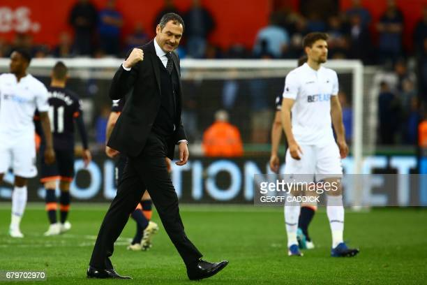 Swansea City's English head coach Paul Clement celebrates on the pitch after the English Premier League football match between Swansea City and...