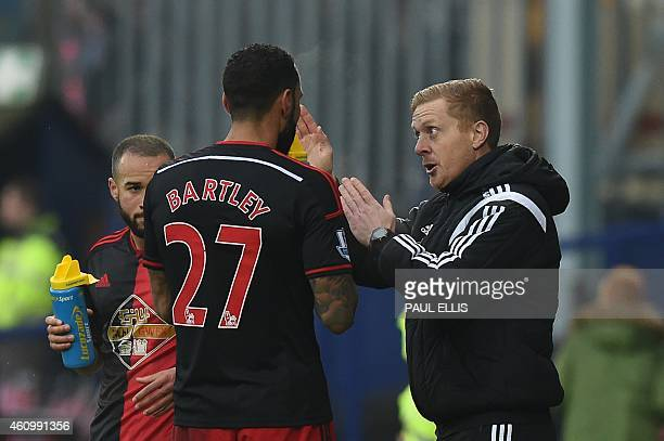 Swansea City's English manager Garry Monk talks with Swansea City's English defender Kyle Bartley during the English FA Cup third round football...