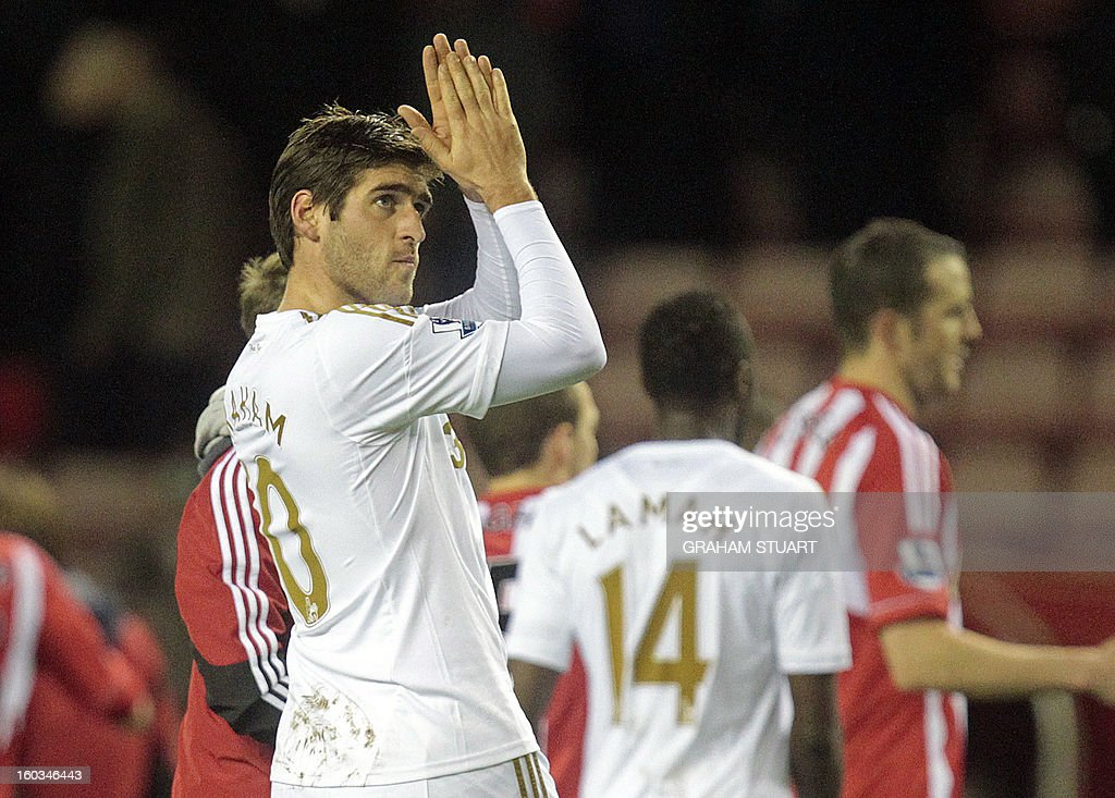 "Swansea City's English midfielder Danny Graham gestures to their supporters after the English Premier League football match between Sunderland and Swansea City at The Stadium of Light in Sunderland, north-east England on January 29, 2013. The game finished 0-0. USE. No use with unauthorized audio, video, data, fixture lists, club/league logos or ""live"" services. Online in-match use limited to 45 images, no video emulation. No use in betting, games or single club/league/player publications"