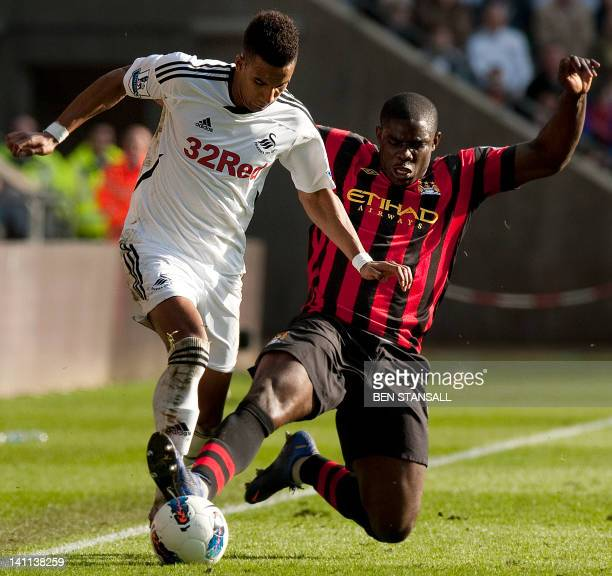 Swansea City's English midfielder Scott Sinclair vies for the ball with Manchester City's English defender Micah Richards during the English Premier...