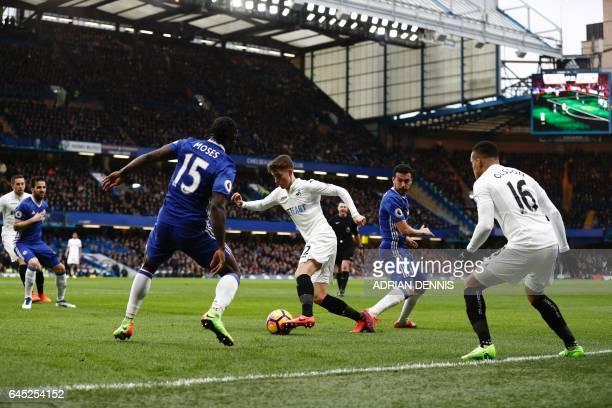 Swansea City's English midfielder Tom Carroll tries to wriggle between Chelsea's Spanish midfielder Pedro and Chelsea's Nigerian midfielder Victor...