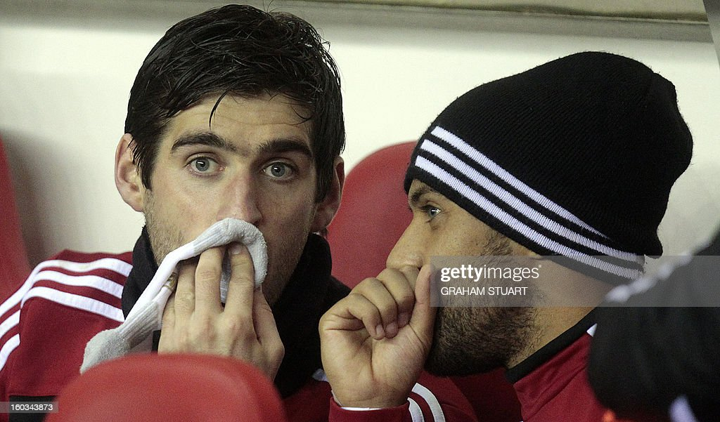 "Swansea City's English striker Danny Graham (L) is seen on the substitute's bench before the English Premier League football match between Sunderland and Swansea City at The Stadium of Light in Sunderland, north-east England on January 29, 2013. AFP PHOTO/GRAHAM STUART USE. No use with unauthorized audio, video, data, fixture lists, club/league logos or ""live"" services. Online in-match use limited to 45 images, no video emulation. No use in betting, games or single club/league/player publications"