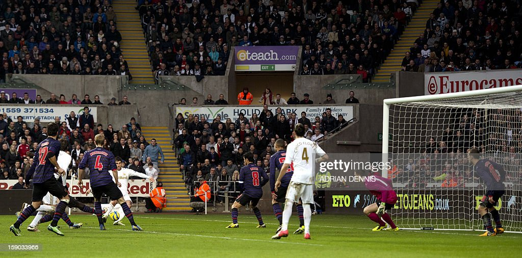 "Swansea City's English striker Danny Graham (4th R) shoots to score their second goal to equalise against Arsenal during the FA Cup third round football match at the Liberty Stadium in Swansea, Wales, on January 6, 2013. The game ended with a 2-2 draw. USE. No use with unauthorized audio, video, data, fixture lists, club/league logos or ""live"" services. Online in-match use limited to 45 images, no video emulation. No use in betting, games or single club/league/player publications"