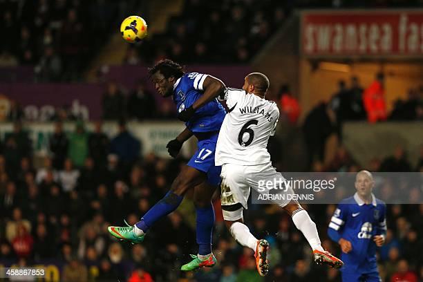 Swansea City's Englishborn Welsh defender Ashley Williams wins a header against Everton's Belgian striker Romelu Lukaku during the English Premier...