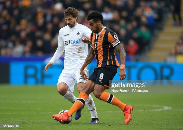 Swansea City's Fernando Llorente and Hull City's Tom Huddlestone battle for the ball during the Premier League match at the KCOM Stadium Hull