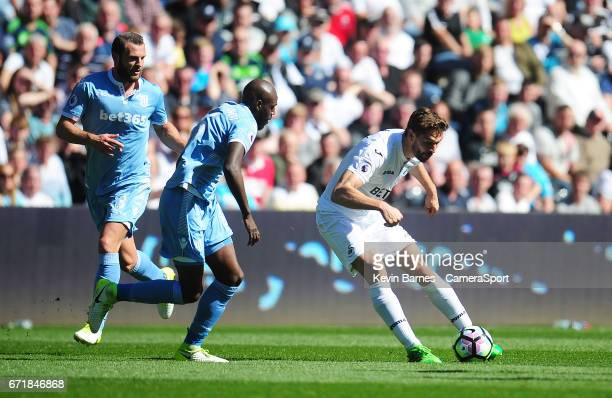 Swansea City's Fernando Llorente under pressure from Stoke City's Bruno Martins Indi during the Premier League match between Swansea City and Stoke...
