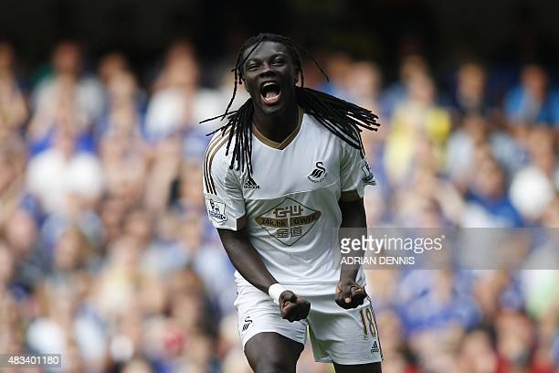 Swansea City's French striker Bafetimbi Gomis reacts after a shot is ruled offside during the English Premier League football match between Chelsea...