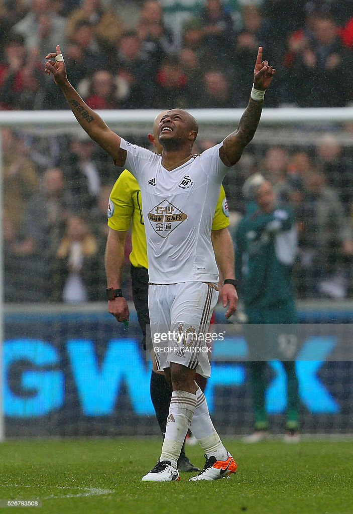 Swansea City's Ghanaian striker Andre Ayew celebrates scoring their third goal during the English Premier League football match between Swansea City and Liverpool at the Liberty Stadium, in Swansea, South Wales, on May 1, 2016. / AFP / GEOFF CADDICK / RESTRICTED TO EDITORIAL USE. No use with unauthorized audio, video, data, fixture lists, club/league logos or 'live' services. Online in-match use limited to 75 images, no video emulation. No use in betting, games or single club/league/player publications. /