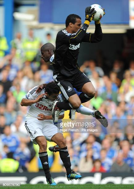 Swansea City's goalkeeper Michel Vorm saves the ball as Chelsea's Ramires challenges for it