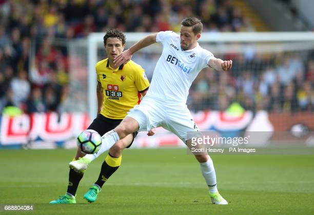 Swansea City's Gylfi Sigurdsson in action with Watford's Daryl Janmaat during the Premier League match at Vicarage Road Watford