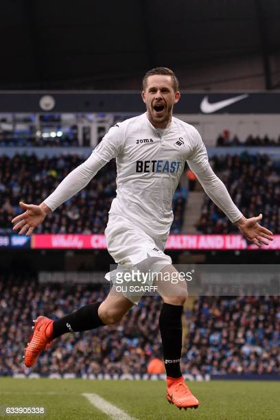 Swansea City's Icelandic midfielder Gylfi Sigurdsson celebrates after scoring their first goal during the English Premier League football match...