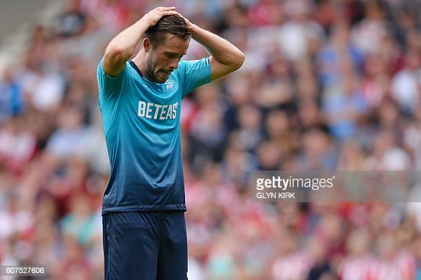 Swansea City's Icelandic midfielder Gylfi Sigurdsson reacts after missing a shot on goal during the English Premier League football match between...