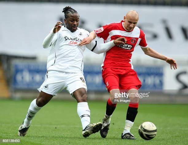 Swansea City's Jason Scotland and Jonjo Shelvey battle for the ball