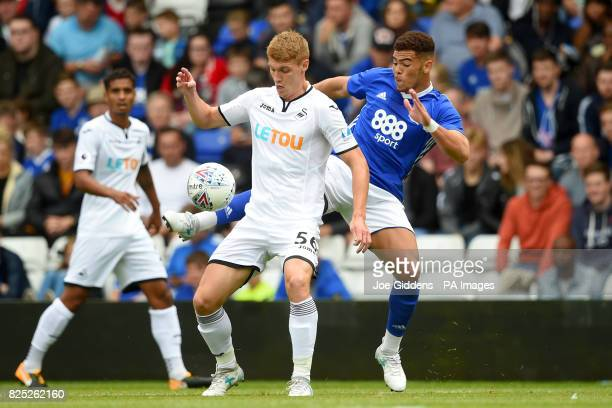 Swansea City's Jay Fulton and Birmingham City's Che Adams battle for the ball