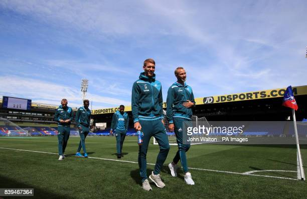 Swansea City's Jay Fulton and Mike van der Hoorn check out the pitch before the Premier League match at Selhurst Park London