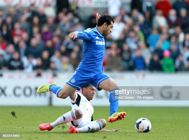 Swansea City's Jonathan de Guzman tackles Chelsea's Mohamed Salah