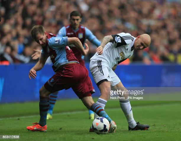 Swansea City's Jonjo Shelvey and Aston Villa's Marc Albrighton battle for the ball