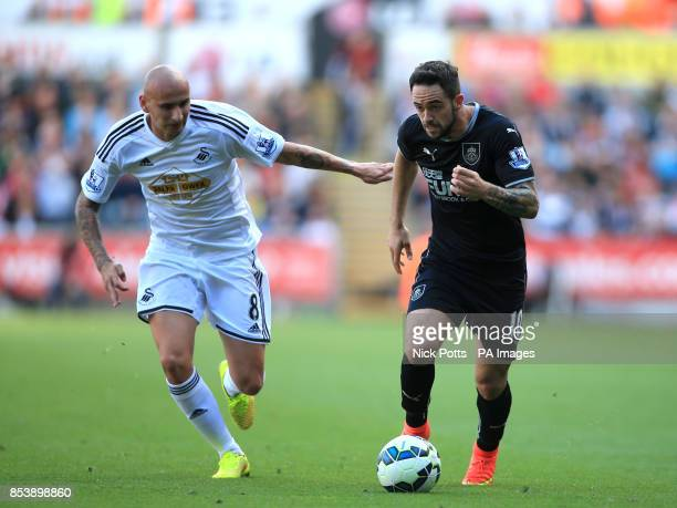 Swansea City's Jonjo Shelvey battles for the ball with Burnley's Danny Ings during the Barclays Premier League match at the Liberty Stadium Swansea