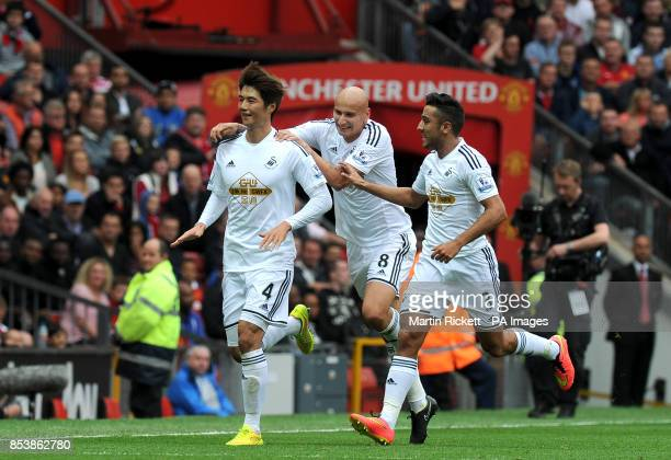 Swansea City's Ki Sungyueng celebrates scoring his side's first goal of the game with teammates Jonjo Shelvey and Neil Taylor during the Barclays...