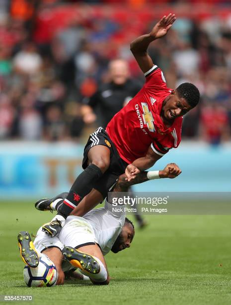 Swansea City's Kyle Bartley challenges Manchester United's Marcus Rashford during the Premier League match at the Liberty Stadium Swansea