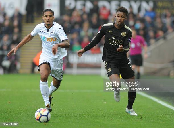 Swansea City's Kyle Naughton vies for possession with Leicester City's Demarai Gray during the Premier League match between Swansea City and...