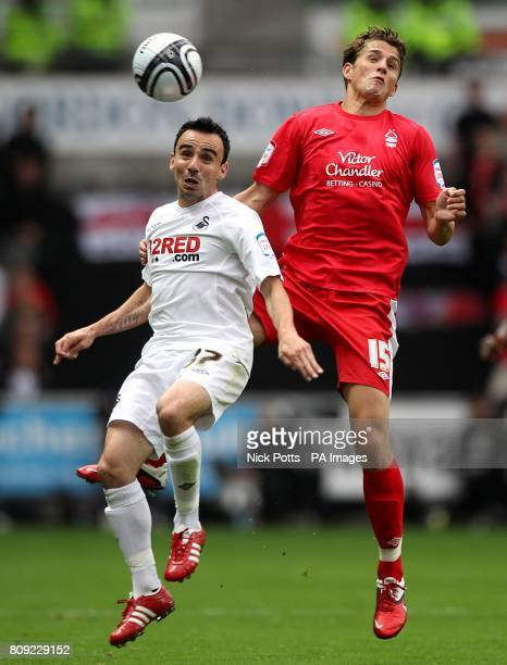 Swansea City's Leon Britton and Nottingham Forest's Chris Cohen battle for the ball