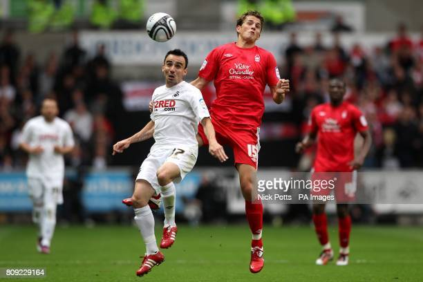 CROP* Swansea City's Leon Britton and Nottingham Forest's Chris Cohen battle for the ball