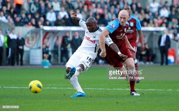 Swansea City's Leroy Lita shoots at goal under pressure from Aston Villa's James Collins during the Barclays Premier League match at the Liberty...