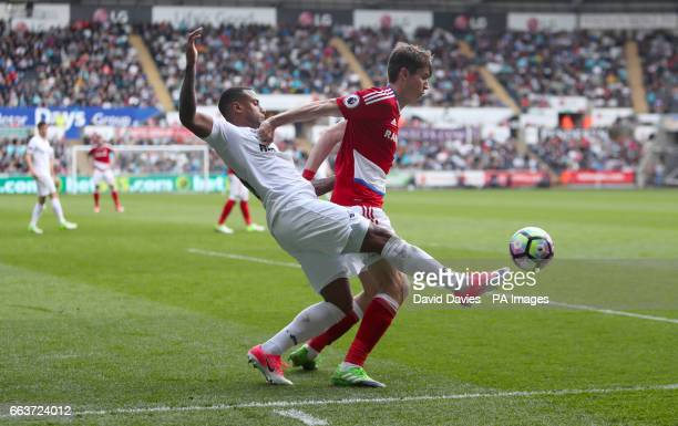 Swansea City's Luciano Narsingh and Middlesbrough's Marten de Roon battle for the ball during the Premier League match at the Liberty Stadium Swansea