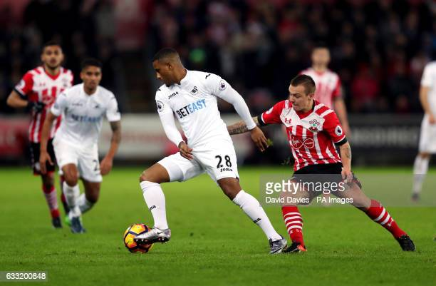 Swansea City's Luciano Narsingh and Southampton's Jordy Clasie battle for the ball during the Premier League match at the Liberty Stadium Swansea