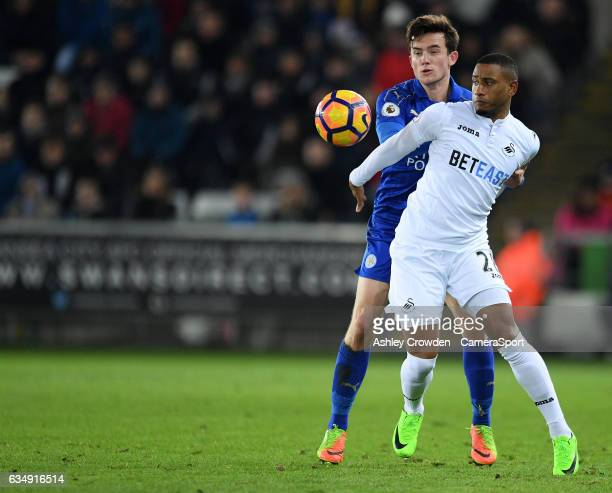 Swansea City's Luciano Narsingh vies for possession with Leicester City's Ben Chilwell during the Premier League match between Swansea City and...