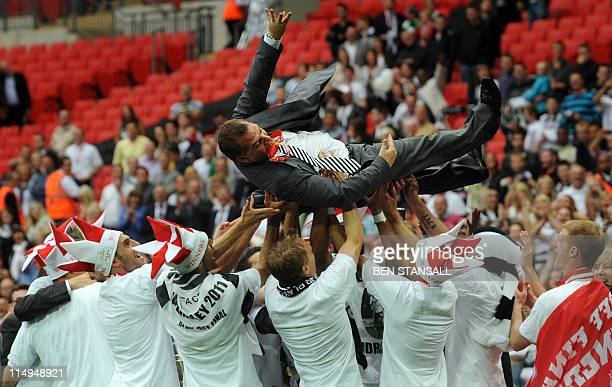 Swansea City's manager Brendan Rodgers is thrown in the air in celebration after his team beat Reading 42 during the 2011 Championship playoff final...