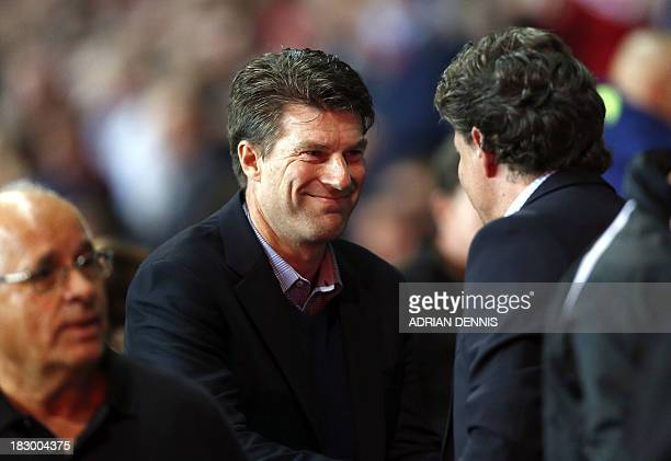 Swansea City's Manager Michael Laudrup shakes hands with FC St Gallen's Manager Jeff Saibene ahead of the Europa League Group A football match...