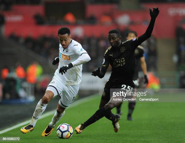 Swansea City's Martin Olsson vies for possession with Leicester City's Wilfred Ndidi during the Premier League match between Swansea City and...