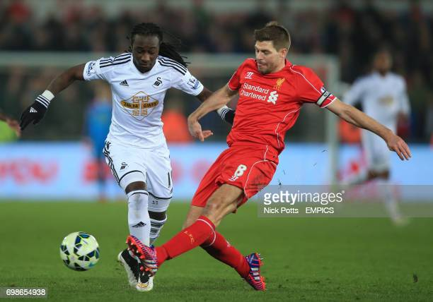 Swansea City's Marvin Emnes battles but loses the ball to Liverpool's Steven Gerrard tackle