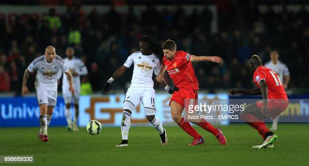 Swansea City's Marvin Emnes holdd off challenge from Liverpool's Steven Gerrard