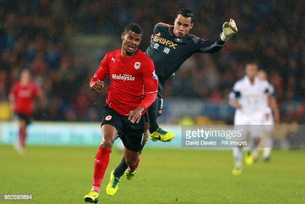 Swansea City's Michel Vorm fouls Cardiff City's Frazier Campbell during the Barclays Premier League match at Cardiff City Stadium Cardiff