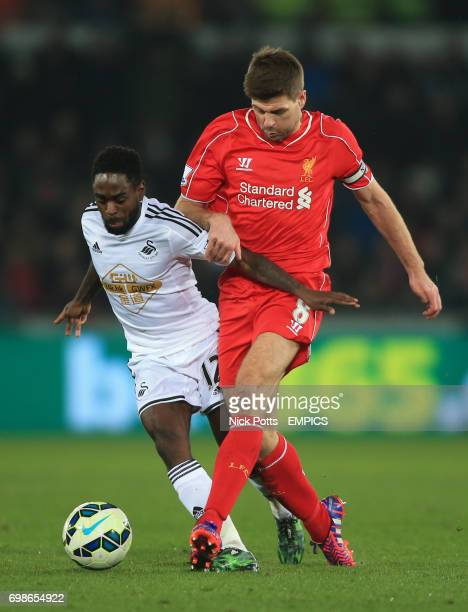 Swansea City's Nathan Dyer battles but loses the ball to Liverpool's Steven Gerrard tackle