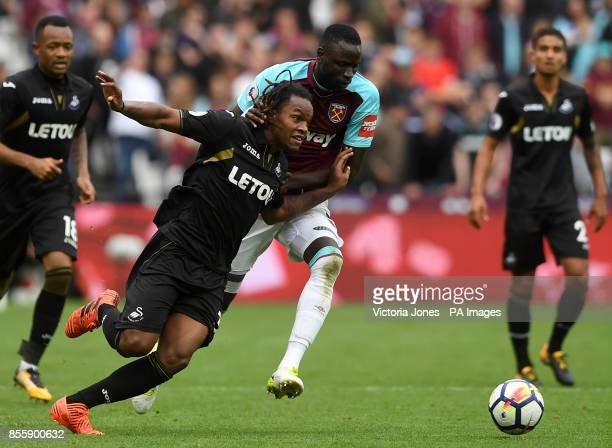 Swansea City's Renato Sanches and West Ham United's Cheikhou Kouyate in action during the Premier League match at London Stadium