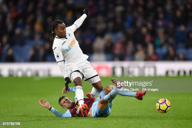 Swansea City's Renato Sanches is tackled by Burnley's Johann Berg Gudmundsson during the Premier League match at Turf Moor Burnley