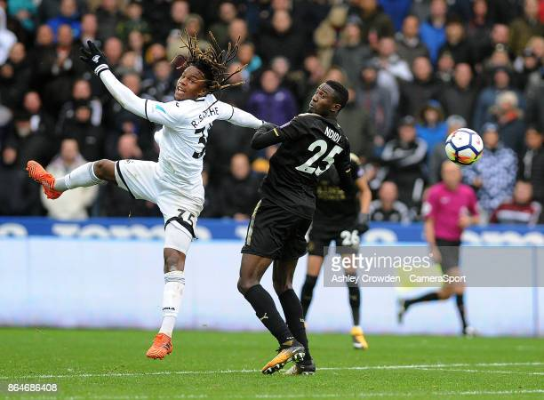 Swansea City's Renato Sanches vies for possession with Leicester City's Wilfred Ndidi during the Premier League match between Swansea City and...