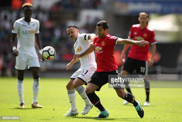 Swansea City's Roque Mesa and Manchester United's Henrikh Mkhitaryan in action during the Premier League match at the Liberty Stadium Swansea