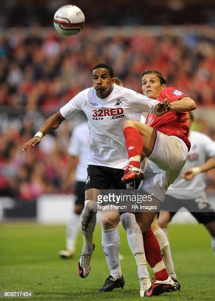Swansea City's Scott Sinclair is challenged by Nottingham Forest's Chris Cohen