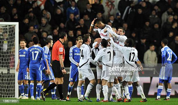 Swansea City's Scott Sinclair is lifted into the air by his teammates after scoring the opening goal against Chelsea during the Premiership match at...