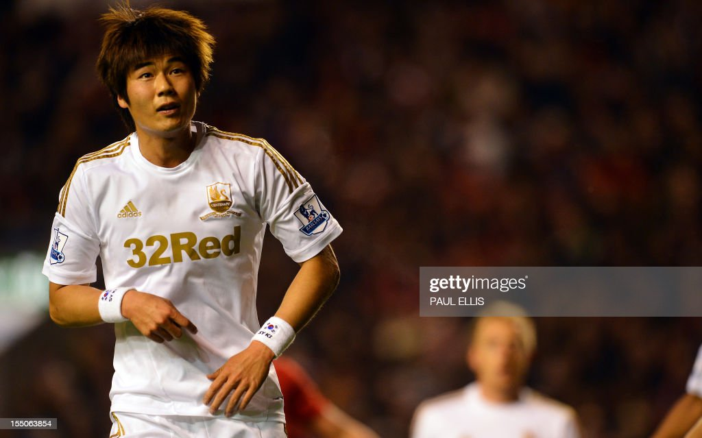 "Swansea City's South Korean midfielder Ki Sung-Yeung (L) looks on during the English League Cup Fourth Round football match between Liverpool and Swansea City at Anfield in Liverpool, north-west England on October 31, 2012. Swansea won the game 3-1. USE. No use with unauthorized audio, video, data, fixture lists, club/league logos or ""live"" services. Online in-match use limited to 45 images, no video emulation. No use in betting, games or single club/league/player publications."