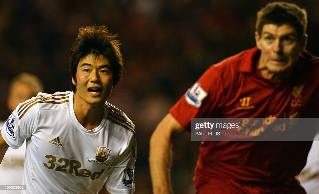 "Swansea City's South Korean midfielder Ki Sung-Yeung (L) vies with Liverpool's English midfielder Steven Gerrard during the English League Cup Fourth Round football match between Liverpool and Swansea City at Anfield in Liverpool, north-west England on October 31, 2012. Swansea won the game 3-1. AFP PHOTO/PAUL ELLIS USE. No use with unauthorized audio, video, data, fixture lists, club/league logos or ""live"" services. Online in-match use limited to 45 images, no video emulation. No use in betting, games or single club/league/player publications."