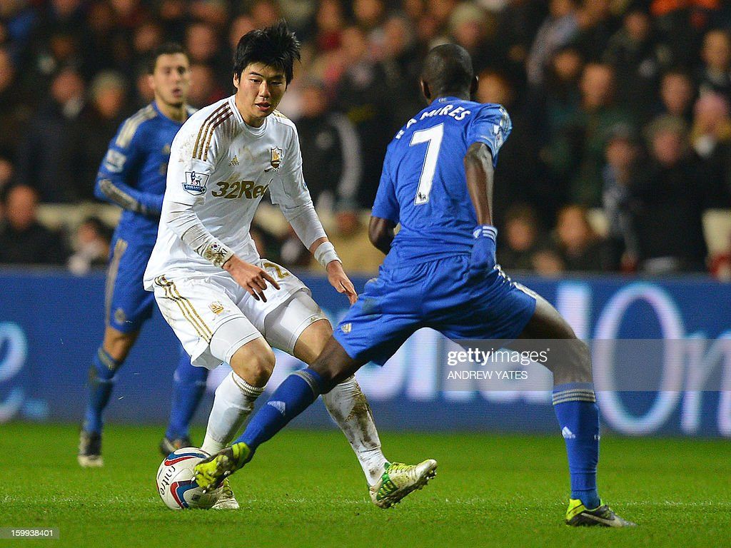 "Swansea City's South Korean midfielder Ki Sung-Yueng (L) vies with Chelsea's Brazilian midfielder Ramires (R) during the English League Cup semi-final second leg football match between Swansea City and Chelsea at The Liberty stadium in Cardiff, south Wales on January 23, 2013. AFP PHOTO/ANDREW YATES USE. No use with unauthorized audio, video, data, fixture lists, club/league logos or ""live"" services. Online in-match use limited to 45 images, no video emulation. No use in betting, games or single club/league/player publications."